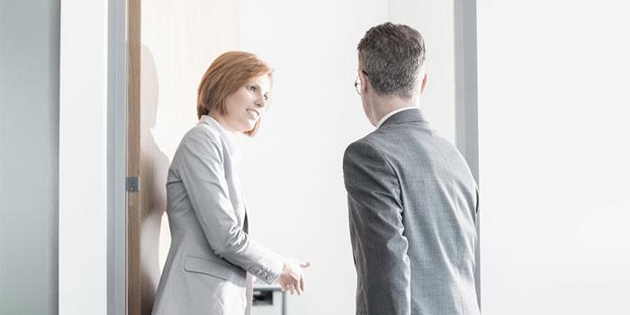 Business people in doorway   Atradius