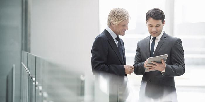 Businessmen with tablet   Atradius